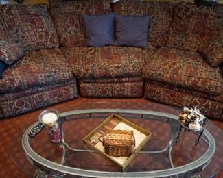 Curved sofa, glass coffee table