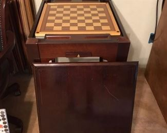 Wood gaming table. Under side of wood top is felt for card games. Inside has pieces and boards for checkers, chess and backgammon. Nice piece!