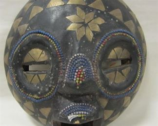 AFRICAN MASK DECORATED WITH BEADS AND INLAID BRASS