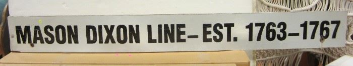 Mason Dixon line sign on plywood.  7' long