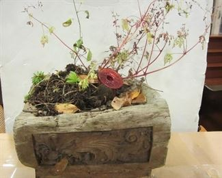 planter made from carved hewn log