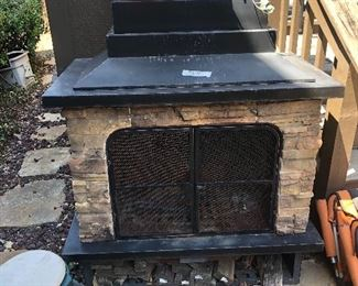 Outdoor rock and iron portable fireplace