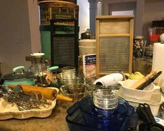 Marked Anchor Hocking blue glass serving/cooking ware, vintage washboards, Chantal bakeware, rolling pins, custard cups, (green pot not for sale)