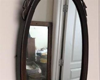 Ornate oval wall mirror