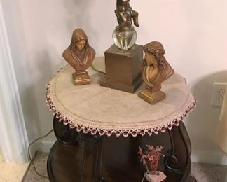 Round, two-tier accent table, Decorative figural lamp, small busts
