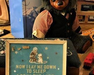 Close up of cross stitch bedtime prayer and Raikes Bear