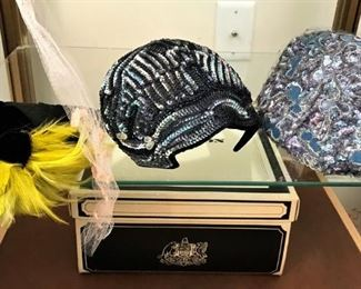 Close up of fascinator and other hats