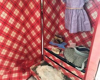 Inside of vintage doll trunk