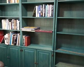 There are boxes of books...that will be in these shelves the day of the sale. These fun Green Bookcase/Cabinets are for sale!