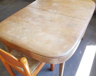 Mid-Century modern Table that needs TLC and four colorful Chairs