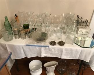 Lots of flower vases (some very unique) and candle holders