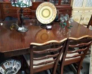 1920's 5' Solid mahogany dining room table with built in leafs & 6 chairs