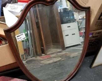 Antique armor shaped framed mirror