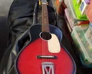Vintage wooden acoustic guitars with case