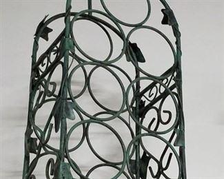 Ornate metal 7 wine bottle holder