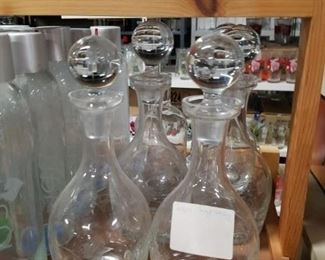 Assorted wine decanters with stoppers