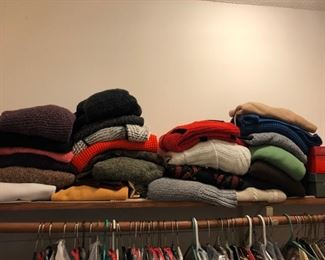 womens clothes. bunches of winter sweaters