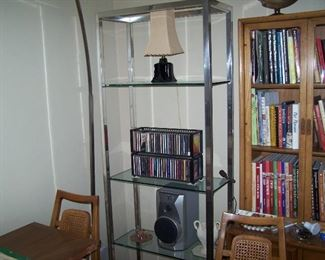 A MATCHING ETAGERE, CDs & ONE OF A PAIR OF 1950s BLACK CERAMIC LAMPS