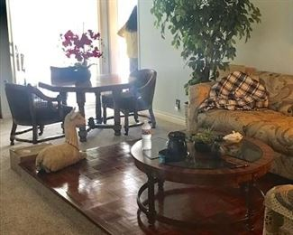 •Round 70s wood table with oval cane back chairs