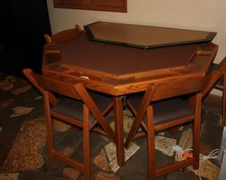 Poker table eight sided with four chairs and top flat cover for regular card playing