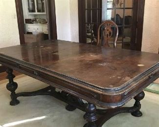 Vintage pre-1930's dining room table with removable leaf.  Has some scratches that can be refinished.  Overall condition is good and sturdy.  Comes with 8 chairs.  Price negotiable.