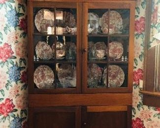 Early 1800's walnut corner cabinet with the original glass.  Beautiful!  Inside the cabinet is a 52 piece set of English Chippendale china.