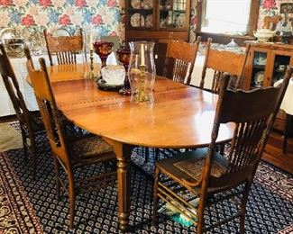 cherry dining table with leaves and pads/the ends also let down .
