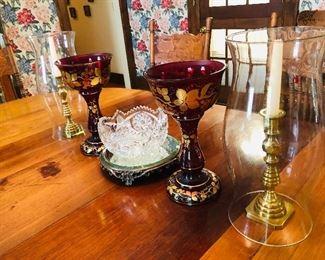 bohemian lustres, brass candlesticks , hurricane shades, lead crystal bowl , beveled mirrored cake plate