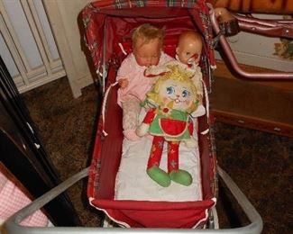 White wooden vintage baby crib, baby pram with dolls
