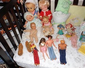 Assorted vintage baby dolls (Madam Alexander, Raggedy Ann, older Barbie, Ken and Midge).  Convertible baby bed with mattress.