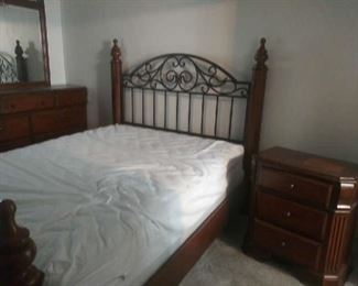 Picture of Wyatt by Ashley Furniture matching bed and nightstand. Set sells for $2500 without mattress/box springs. Asking $500 for all.