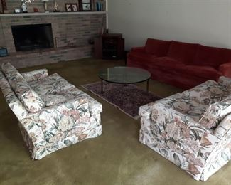 2 Floral Loveseats in really good conditions except for stuffing on the two top pillows.