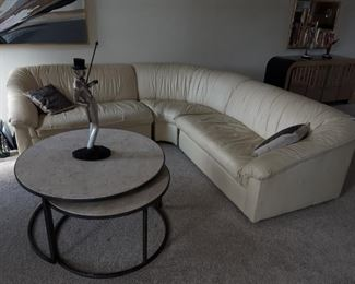 Matching smaller leather sectional with coordinating coffee table