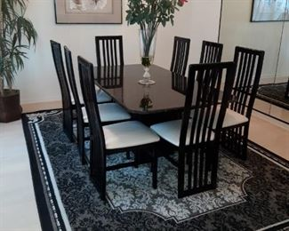 Fabulous black lacquer dining room table with granite top and 8 chairs, black and white rooms size rug, other art
