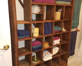 Very charming vintage rack/bookcase...holds anything!