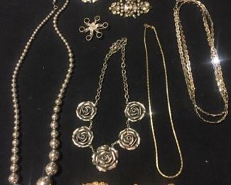 silver pins and necklaces