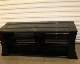 black glass and plastic entertainment console
