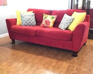 Red Sofa with Assorted Pillows