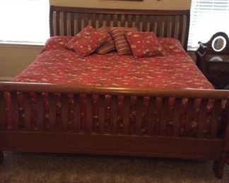 Beautiful king sleigh bed made of solid oak. Very high-quality. Also spring air mattress and box springs