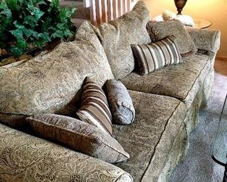 Here's A Pretty Slip Covered Sofa...And Plenty Of Pillows...