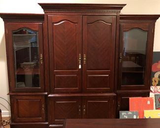 Entertainment center - lighted side cabinets, recessed doors, room for stereo system