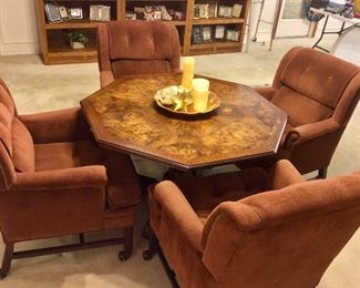 Solid wood game table with four comfortable arm chairs.