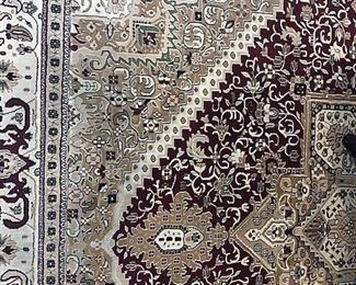 Oriental rug (10 x 14) in tan, white and burgandy