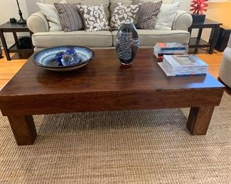 The coffee table and red sculpture on the right are sold.