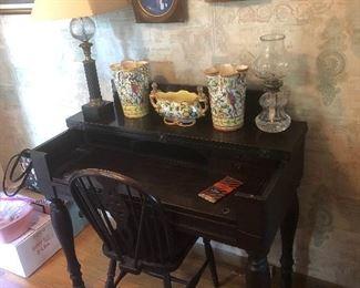 antique wooden secretary, antique chair, vases, lamp