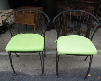 Pair of wrought iron chairs with cushions