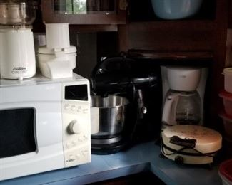 lots of small appliances, clean and ready for use. a good stack of plastic containters, also clean and ready for use.