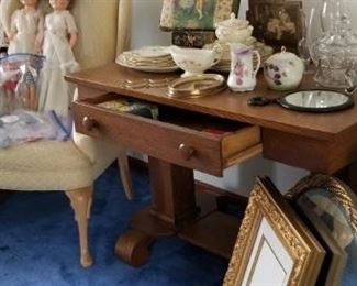 an oak library table with drawer. victorian photo album on brass stand. tilt frame, mirror, ohio art cupid pair. a nice frame and an ornate gold round mirror. Barbie and Ken (circa 63-64) with original barbie marked clothing. clean, ironed and ready. cobalt blue glass pieces.