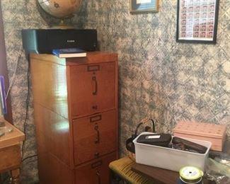 Canon printer, wood file cabinet, globe