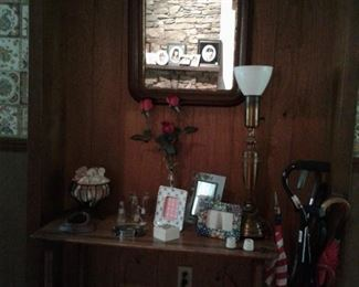 vintage hall table, frames, vintage lamp, umbrellas and canes